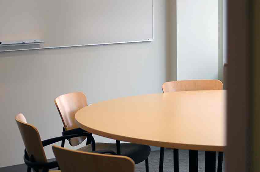 Picture of office table with two chairs