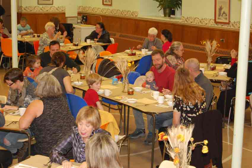 World Food Day guests enjoying the meal togethert