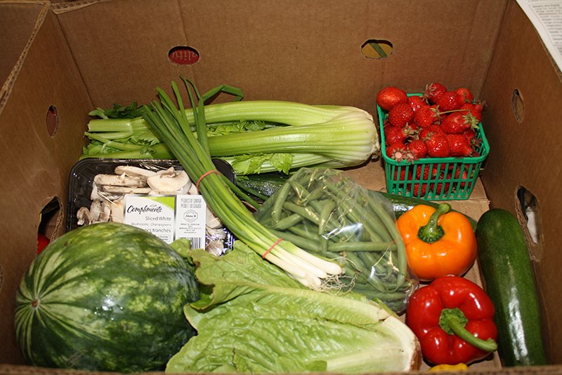 A cardboard box filled with fresh produce