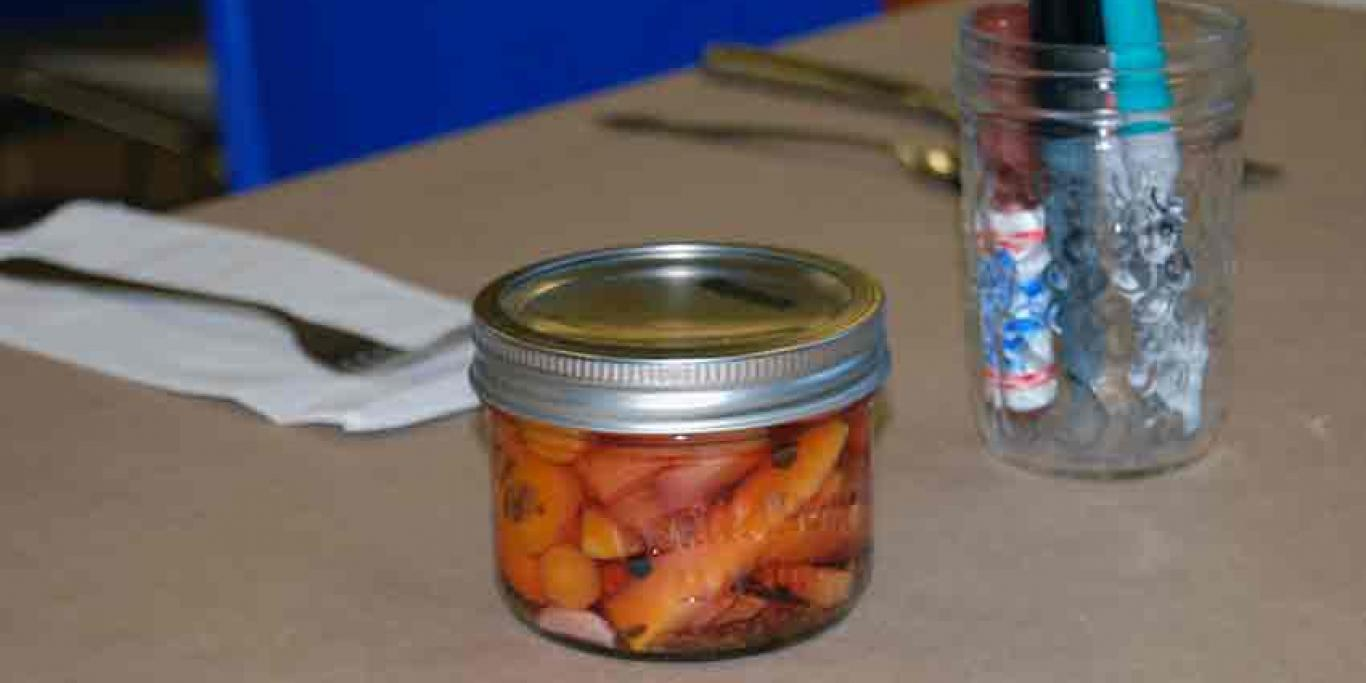 Close up photo of canned pickled carrots