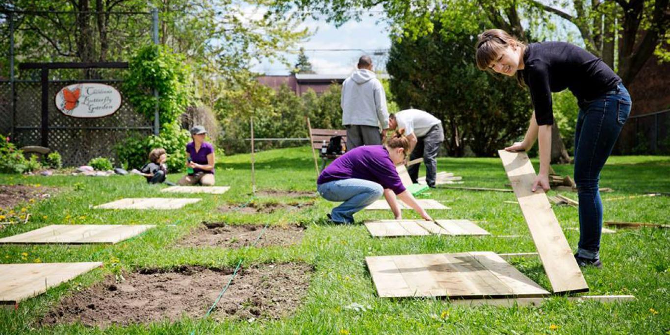 Community gardeners building raised beds